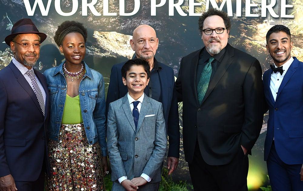 Giancarlo Esposito, from left, Lupita Nyong'o, Neel Sethi and Ben Kingsley, Jon Favreau and Ritesh Rajan arrive at the premiere of