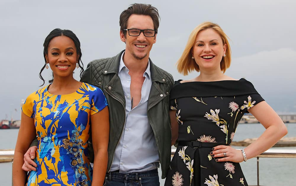 Left to right, American singer and actress Anika Noni Rose, Irish actor Jonathan Rhys Meyers and Canadian born New Zealand actress Anna Paquin, pose for photographers during the MIPTV, International Television Programme Market.
