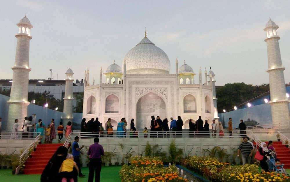 People admire the foldable and movable replica of Taj Mahal in Bengaluru.