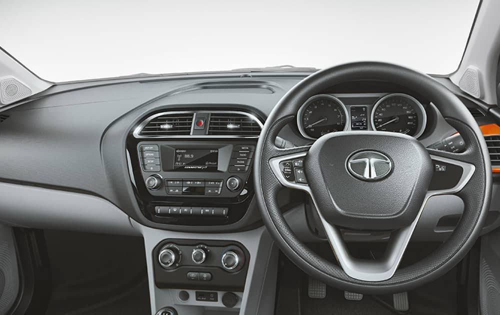 Dual tone interior, customizable air vents and premlum graphics on fabric. (Pic courtesy: http://madeofgreat.tatamotors.com/tiago/)