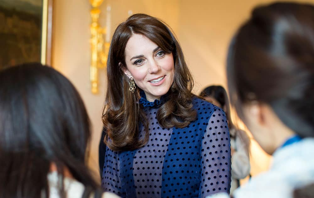 Kate, the Duchess of Cambridge attends a reception at Kensington Palace, ahead of their tour to India and Bhutan.