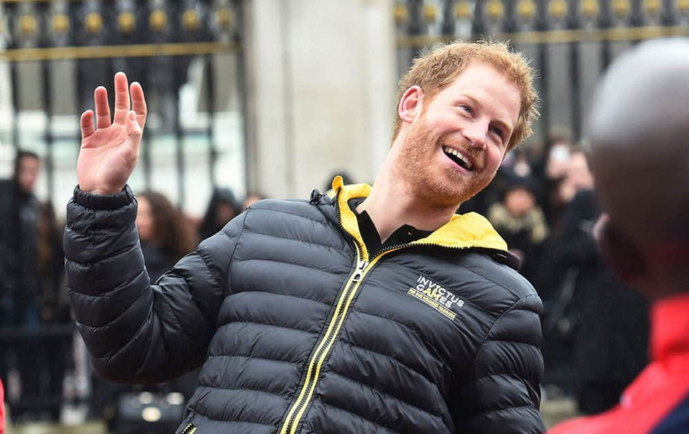 Britains Prince Harry, 2nd left, talks to members of the UK team for the upcoming Invictus Games 2016, at Buckingham Palace in London.
