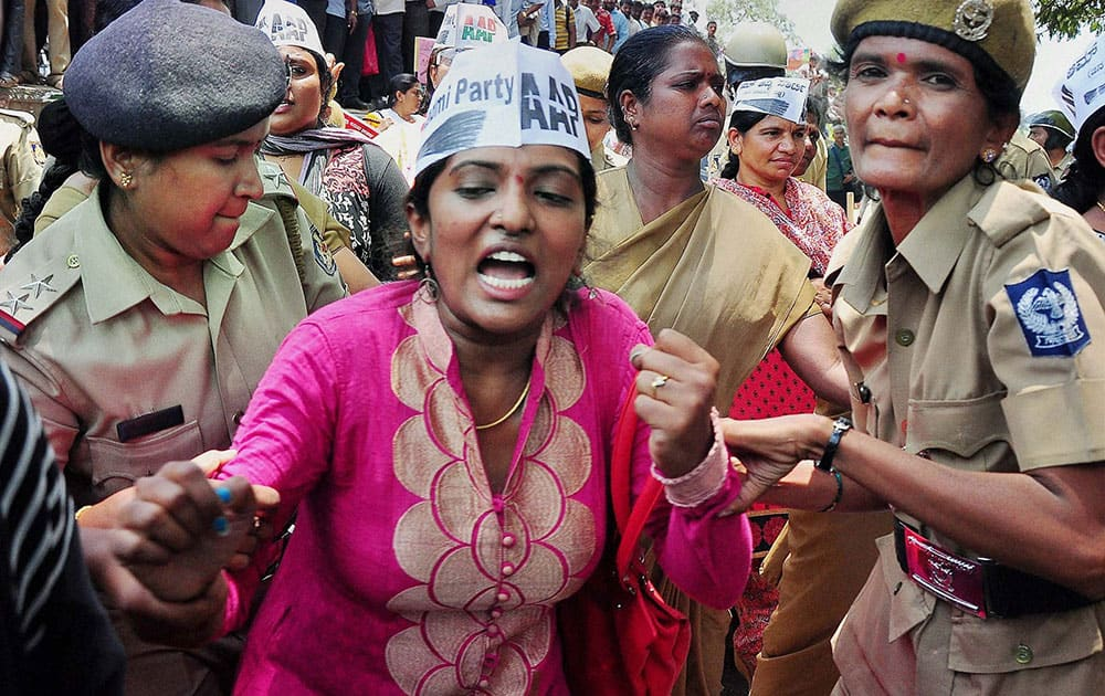 Police detain a woman AAP activist during a protest march towards the Chief Ministers office against the creation of the Anti Corruption Bureau.
