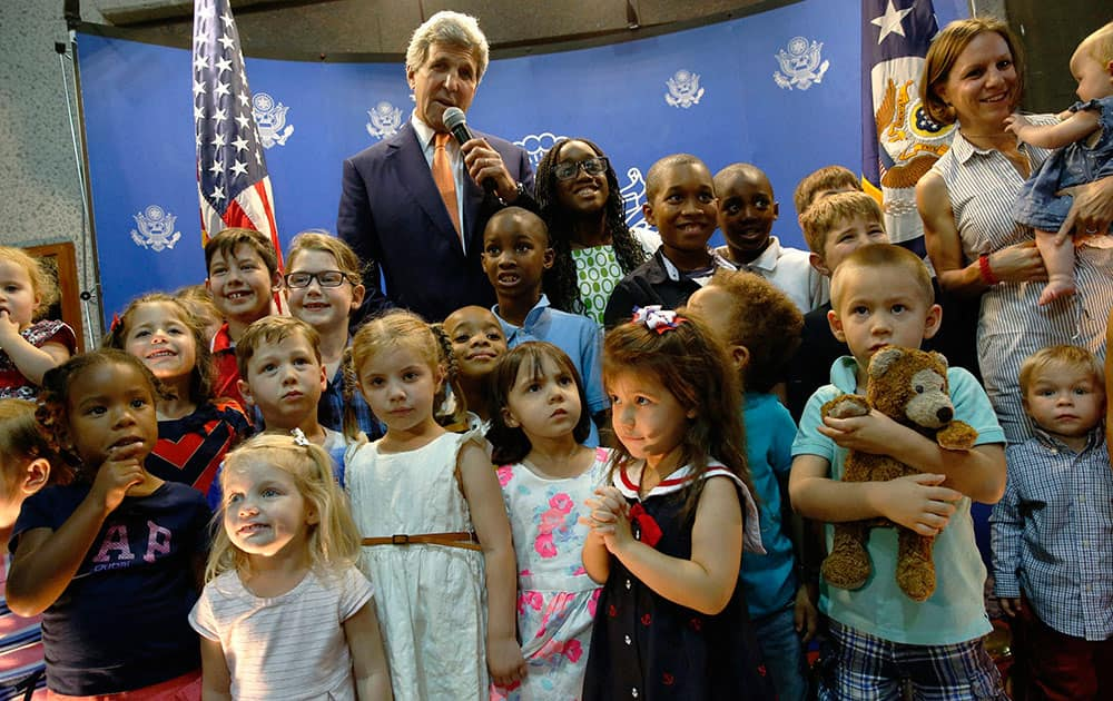 Secretary of State John Kerry meets with US embassy staff and their children at the embassy in Manama, Bahrain.