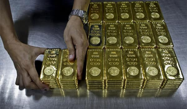 Gold price slips as equities recover, still set for weekly gain