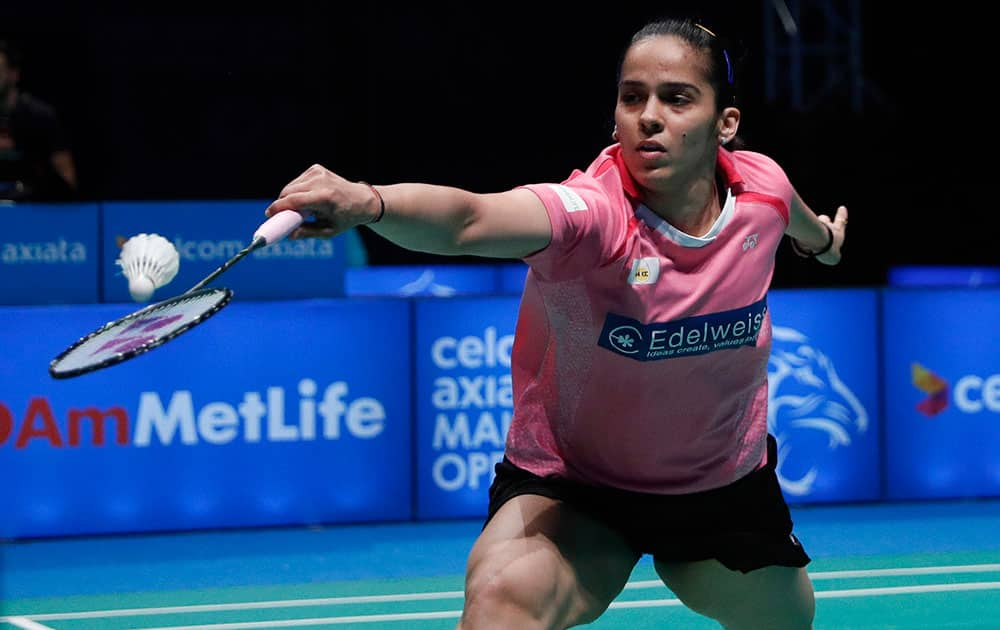 Saina Nehwal of India returns a shot to Tai Tzu Ying of Taiwan during their women's singles semi final match at the Malaysia Open Badminton Superseries in Shah Alam, Malaysia.