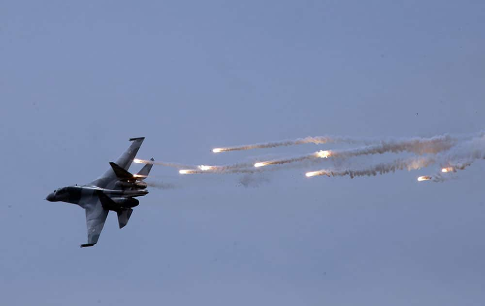 An Indonesian fighter jet releases flares during a show in Jakarta, Indonesia.