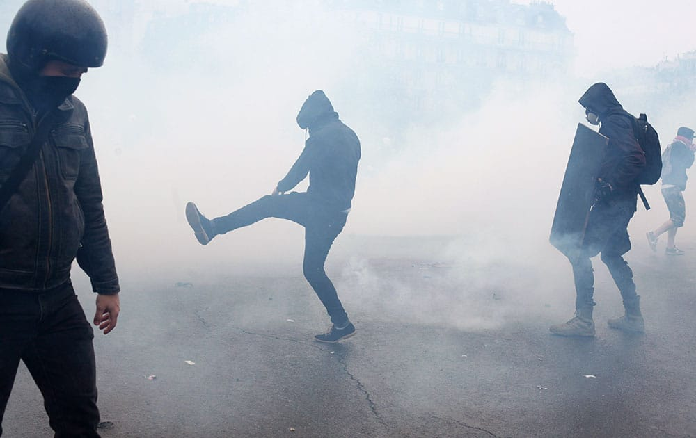Demonstrators during clashes against police officers, as part of a protest against the proposed changes to France's working week and layoff practices, in Paris.