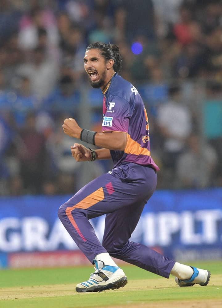 Rising Pune Supergiantss Ishant Sharma celebrates the wicket of Mumbai Indianss batsman Rohit Sharma during the IPL 2016 in Mumbai.