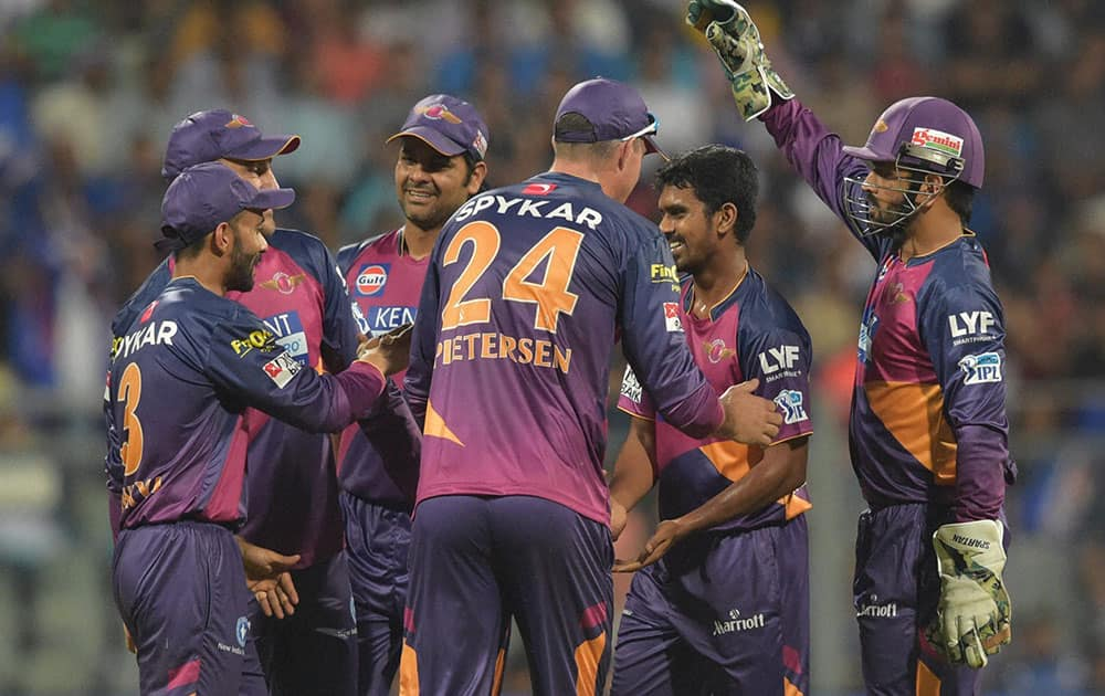 Rising Pune Supergiantss players celebrates the wicket of Mumbai Indianss Shreyash Gopal during the IPL 2016 opening match played in Mumbai.