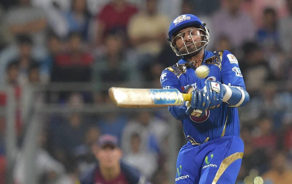 Mumbai Indians batsman Harbhajan Singh plays a shot during the IPL 2016 opening match played against Rising Pune Supergiants in Mumbai.