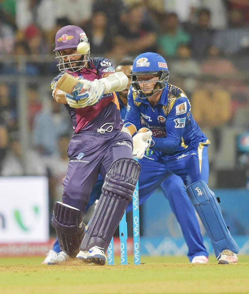 Rising Pune Supergiants batsman Ajinkya Rahane plays a shot during the IPL 2016 opening match played against Mumbai Indians in Mumbai.