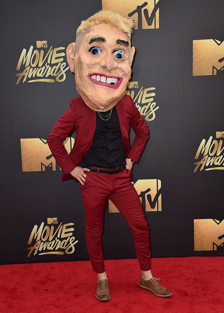 Mike Posner arrives at the MTV Movie Awards at Warner Bros. Studios in Burbank, Calif.