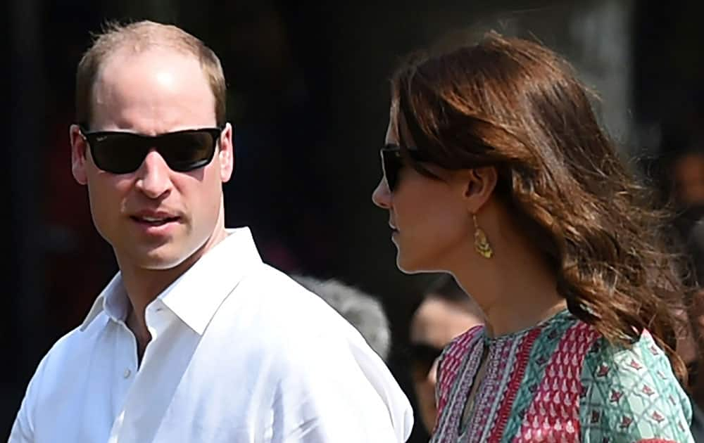 The Duke and Duchess of Cambridge, Prince William, and his wife, the former Kate Middleton, walk with officials during a charity event at the Oval Maidan in Mumbai, India.
