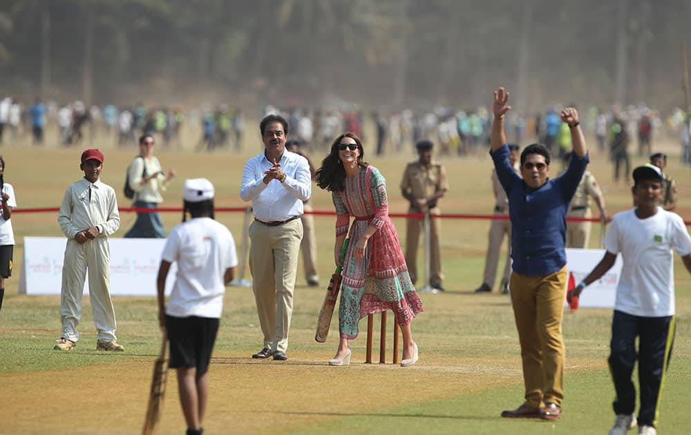 Britain's Kate, the Duchess of Cambridge, plays cricket at Oval Maidan in Mumbai, India.