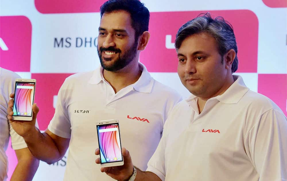 Cricketer MS Dhoni along with Vice President and head marketing-communication Lava International limited Solomon Wheeler during the announcement of MS Dhoni as a Lava brand ambassador, in Mumbai.
