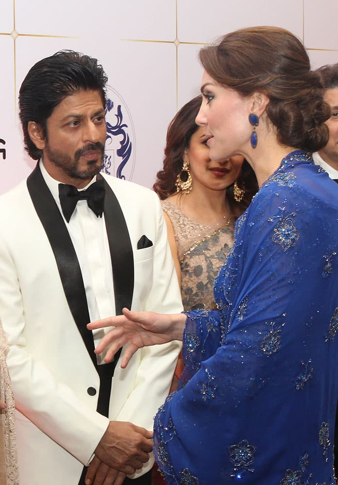 Kate, the Duchess of Cambridge, right, speaks with Bollywood star Shah Rukh Khan, during a charity ball at the Taj Mahal Palace hotel in Mumbai.