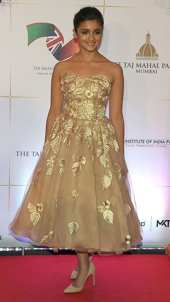 Bollywood actress Alia Bhatt poses for photographers after arriving for a charity ball at the Taj Mahal Palace hotel attended by the Duke of Cambridge, Prince William, and his wife, Kate, the Duchess of Cambridge, in Mumbai.