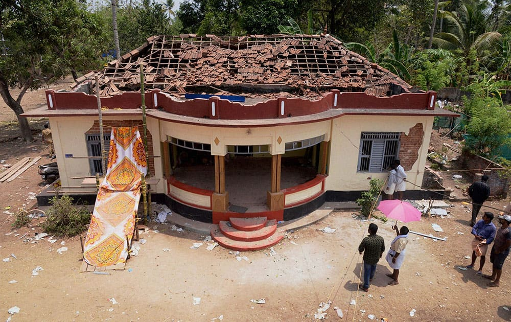 A view of a damaged building after a massive fire broke out during a fireworks display at the Puttingal temple complex in Paravoor village, north of Thiruvananthapuram, southern Kerala state.