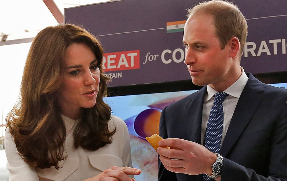 Britain's Prince William eats a