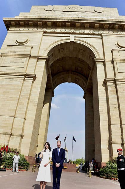 Britains Prince William and his wife, Kate Middleton, the Duchess of Cambridge pose at India Gate in New Delhi.