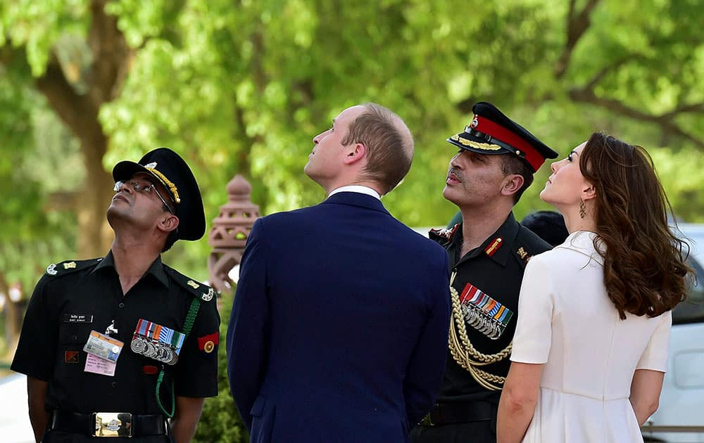 Britains Prince William and his wife, Kate Middleton, the Duchess of Cambridge at India Gate in New Delhi.