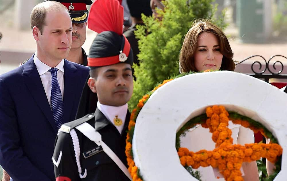Britains Prince William and his wife, Kate Middleton, the Duchess of Cambridge pay homage at India Gate in New Delhi.