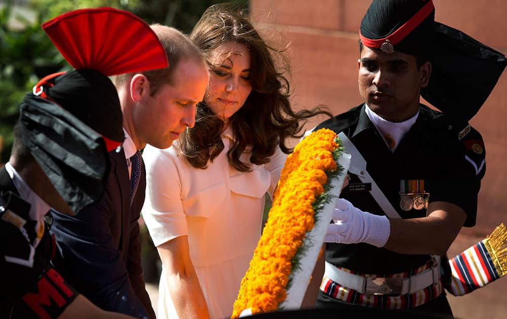 Britain's Prince William, along with his wife Kate, the Duchess of Cambridge pay their tributes at the India Gate war memorial, in the memory of the soldiers from Indian regiments who served in World War I, in New Delhi.