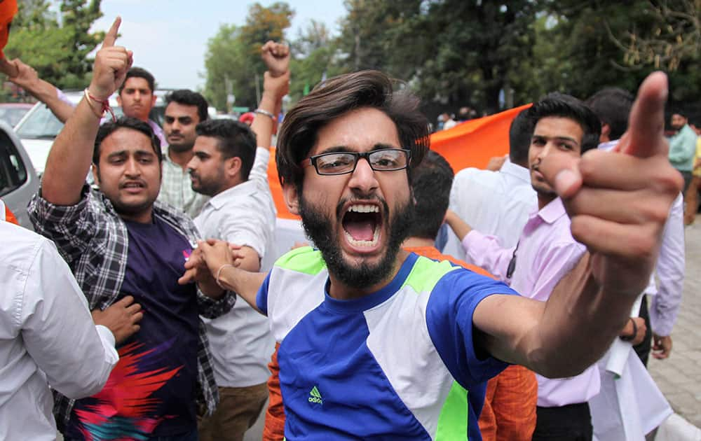 Activists of ABVP protest in front of the vehicle of Director General of Jammu and Kashmir Police over NIT Kashmir issue, in Jammu.