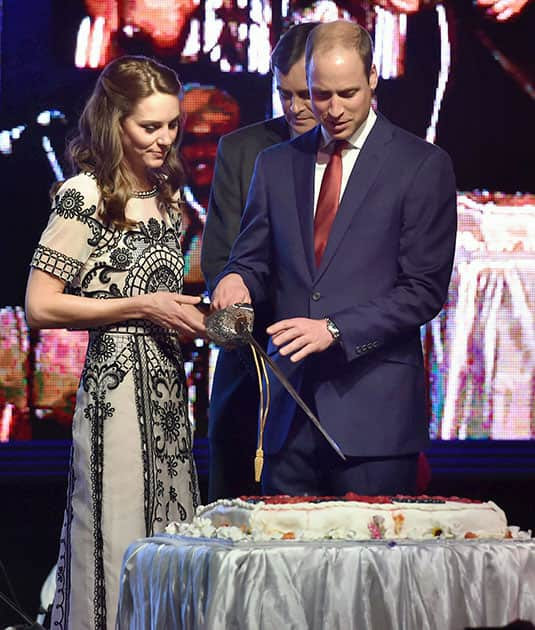 Britain's Prince William, and his wife Kate, the Duchess of Cambridge,cut a cake to celebrate Queen Elizabeth's 90th birthday, which is April 21 at the residence of British High Commissioner in New Delhi.