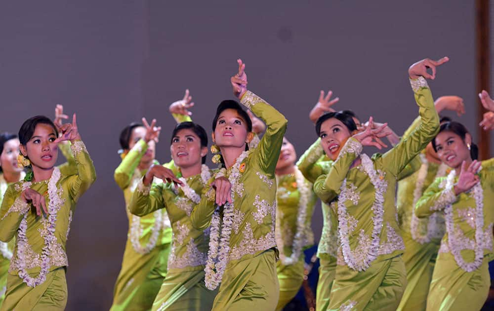 Myanmar performers present traditional dance during a ceremony to mark Myanmar water festival at the Presidential Palace.