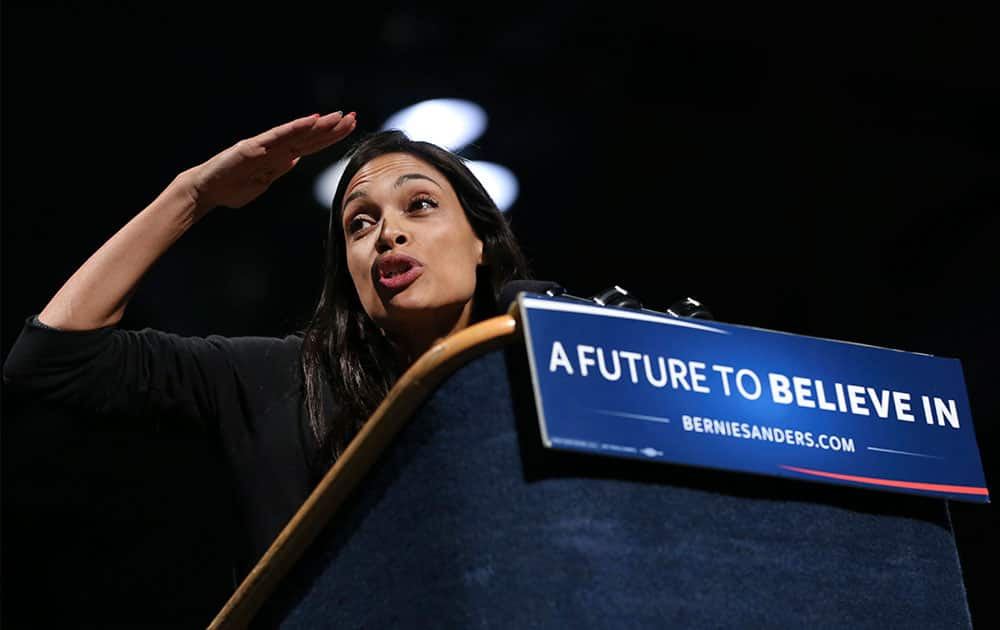 Actress Rosario Dawson looks out at the audience as she prepares to introduce Democratic presidential candidate, Sen. Bernie Sanders, I-Vt., at a campaign rally.