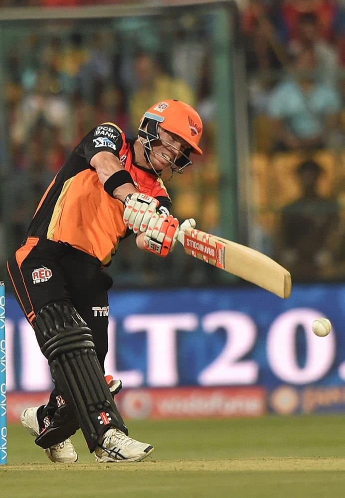 Sunrisers Hyderabad batsman David Warner plays a shot against Royal Challengers Bangalore during the IPL 2016 match at Chinnaswamy stadium in Bengaluru.