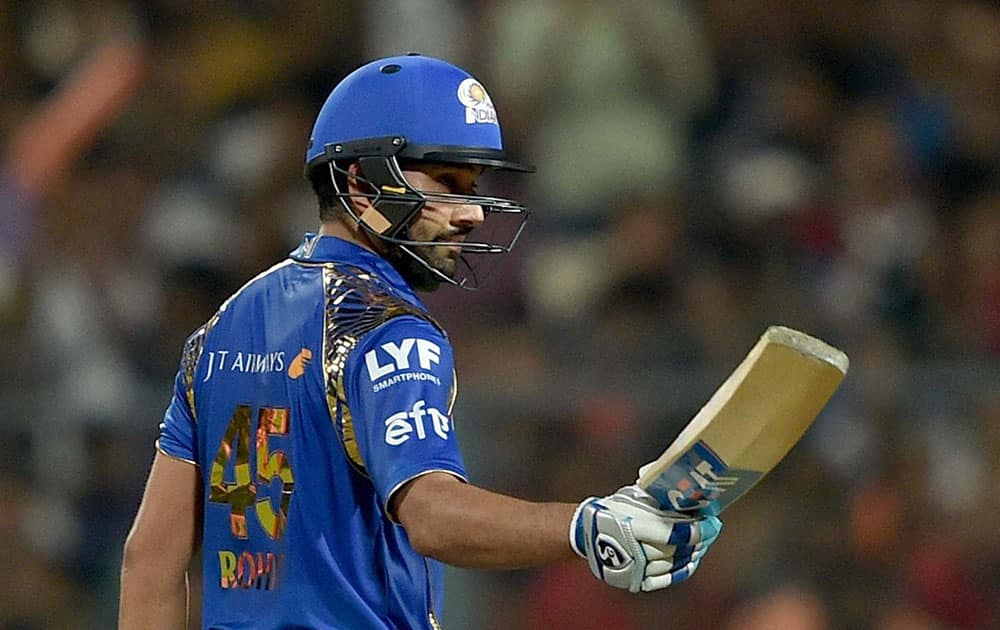 Mumbai Indian batsman Rohit Sharma acknowledges the cheers from the crowd after completing his half century during IPL Match against KKR in Kolkata.