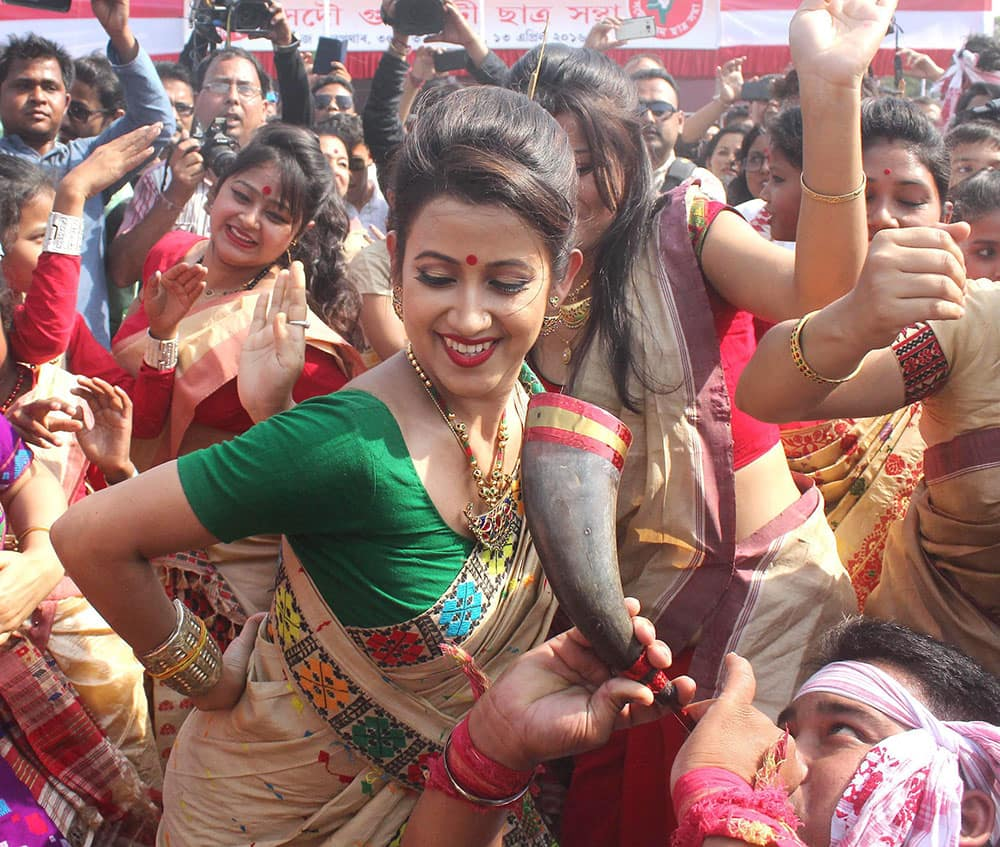 Assamese film actors perform during the celebrations of Rongali Bihu festival in Gawahati.