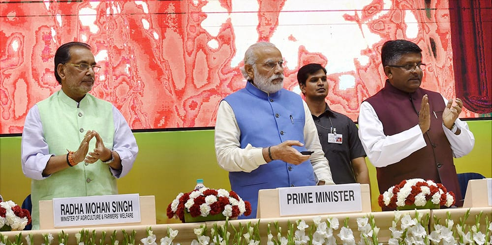 Prime Minister Narendra Modi with Union Agriculture and Farmers Welfare Minister, Radha Mohan Singh and Union Minister for Communications & IT, Ravi Shankar Prasad launches the National Agriculture Market, an e-market, in New Delhi.