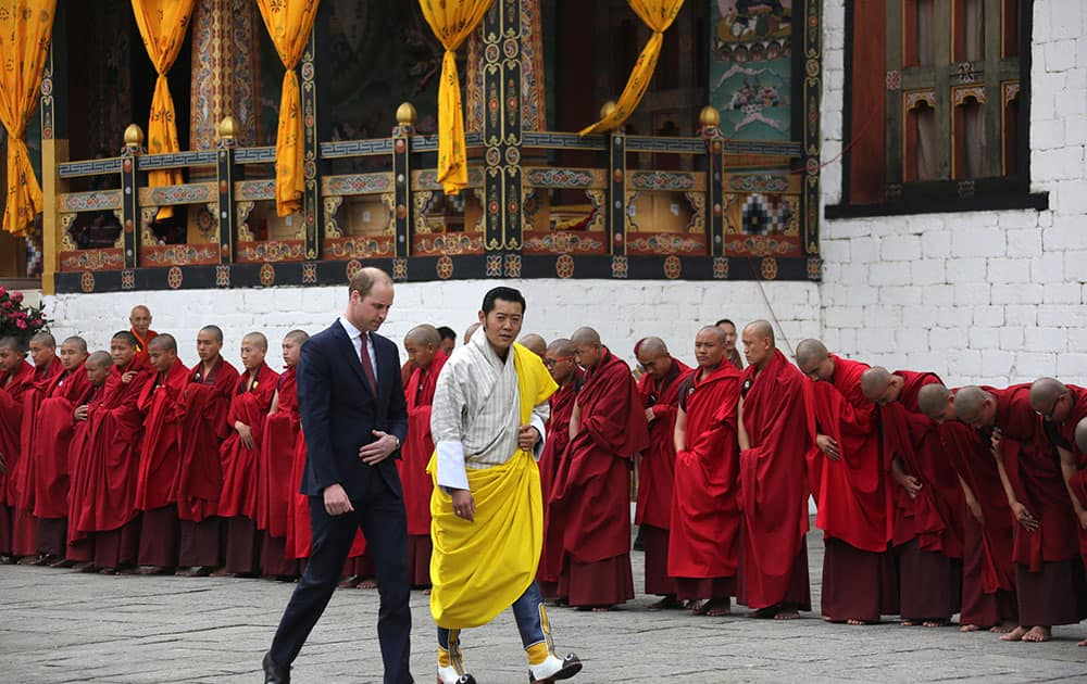 This photo provided by Royal Kingdom of Bhutan, Britain's Prince William left, walks with Bhutan's king, Jigme Khesar Namgyel Wangchuk, in Thimphu, Bhutan.
