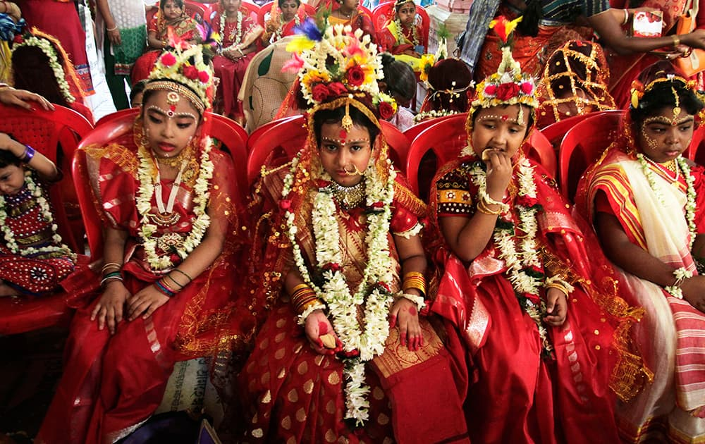 Young girls yet to attain puberty are dressed up as living goddesses before being worshipped as 'kumari' or virgin during the Bengali Hindu festival of Basanti Durga puja performed in the spring in Kolkata