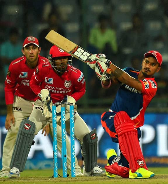 Delhi Daredevils batsman Pawan Negi plays a shot against Kings XI Punjab during their IPL match at Feroz Shah Kotla Stadium in New Delhi.