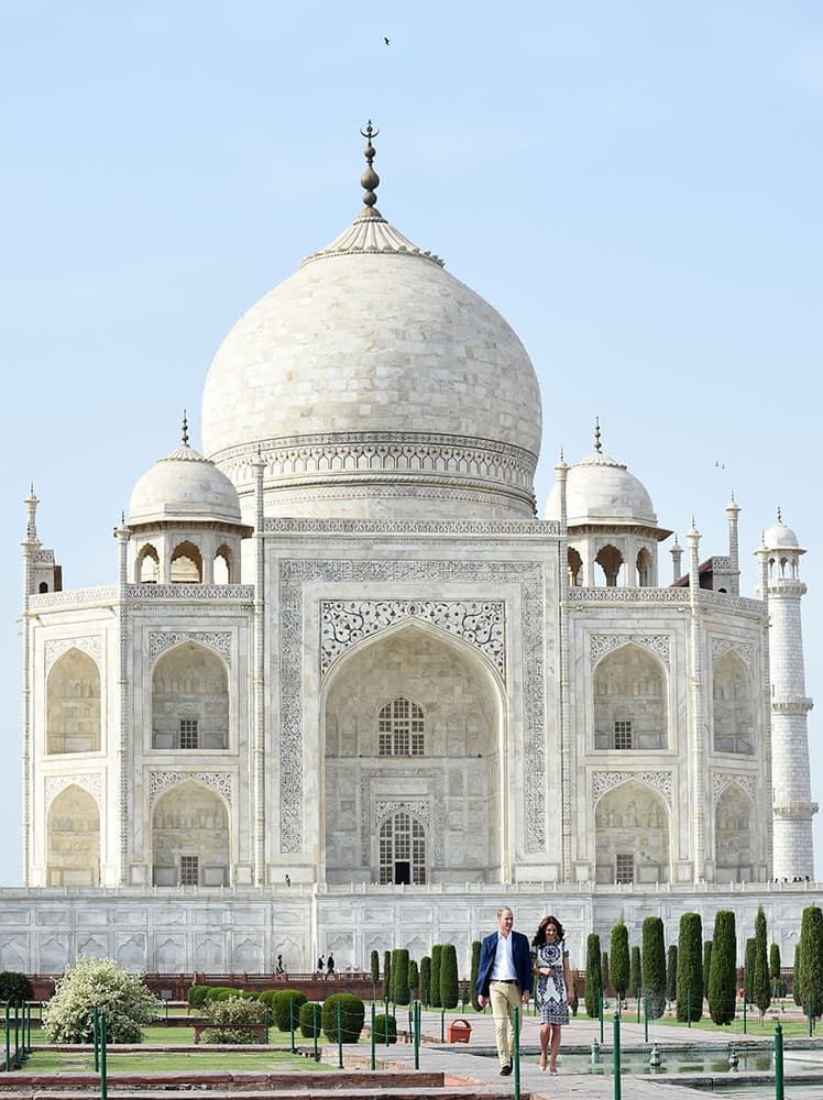 Britain's Prince William, along with his wife, Kate, the Duchess of Cambridge, walk during their visit to the Taj Mahal in Agra, India.
