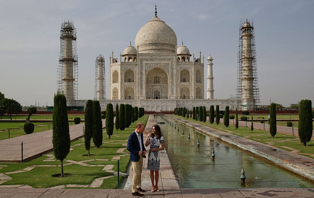 Britain's Prince William, along with his wife, Kate, the Duchess of Cambridge, pose in front of the Taj Mahal in Agra, India.