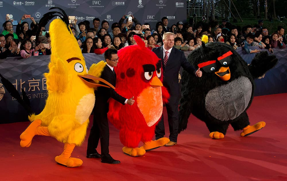 People dressed as characters from the Angry Birds movie pose for photos at the red carpet for the 6th Beijing International Film Festival, held on the outskirts of Beijing, China.
