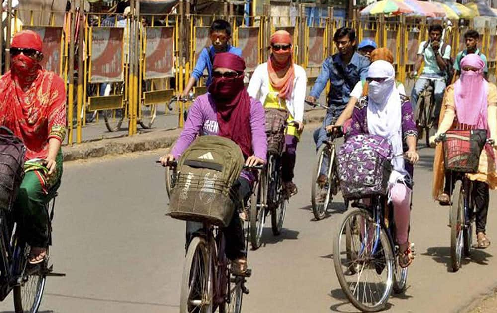College goers cover their face to protect from heat in Bankura district in West Bengal.