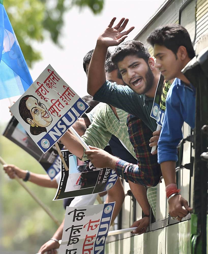NSUI activists shout slogans as they are being detained during a protest to demand resignation of HRD Minister Smriti Irani against Lathicharge on students of NIT Srinagar, in New Delhi.