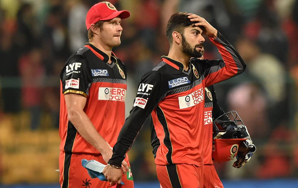 Royal Challengers Bangalore Skipper Virat Kohli and Shane Watson returns the pavilion after they lost against Delhi Daredevils during Indian Premier League (IPL) 2016 T20 match in Bengaluru.