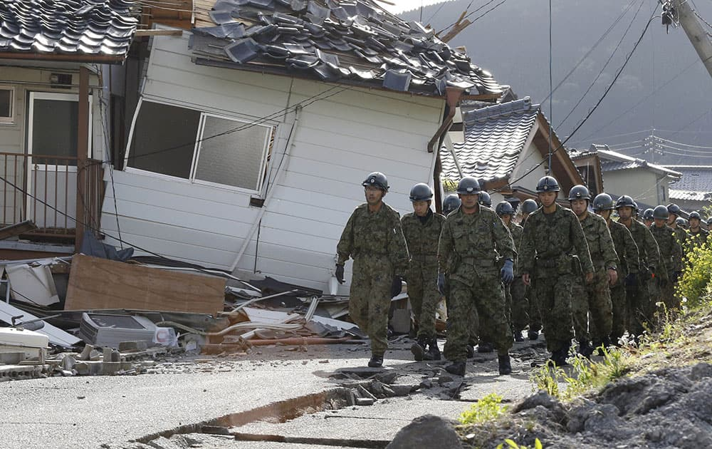 Japan Self-Defense Forces members work the damage area caused by earthquakes in Minamiaso, Kumamoto prefecture, Japan.