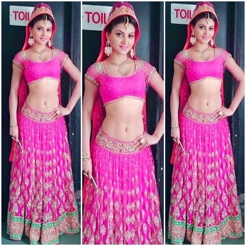 URVASHI RAUTELA :- #happysunday #pink in beautiful @neeta_lulla lehenga #throwback styled by @surabhi_stylefiles -instagram