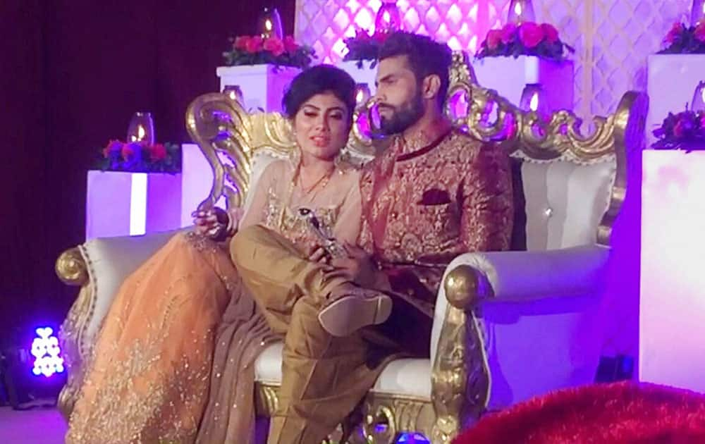 Cricketer Ravindra jadeja with his wife Rivaba during their wedding ceremony in Rajkot.