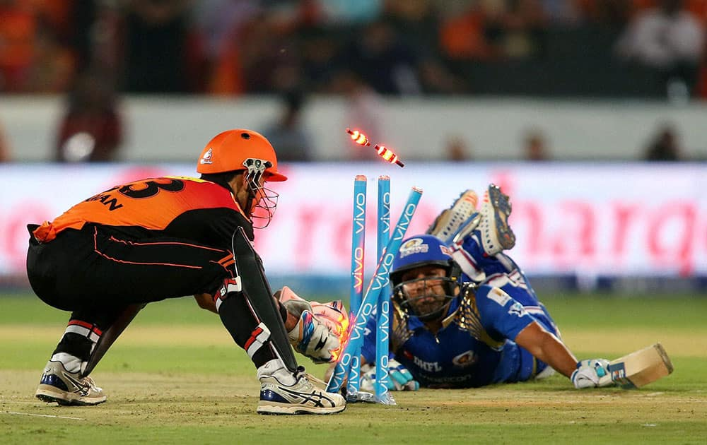 Sunrisers Hyderabads wicketkeeper Naman Ojha breaks the wickets to run out Mumbai Indians captain Rohit Sharma during Indian Premier League (IPL) 2016 T20 match in Hyderabad,
