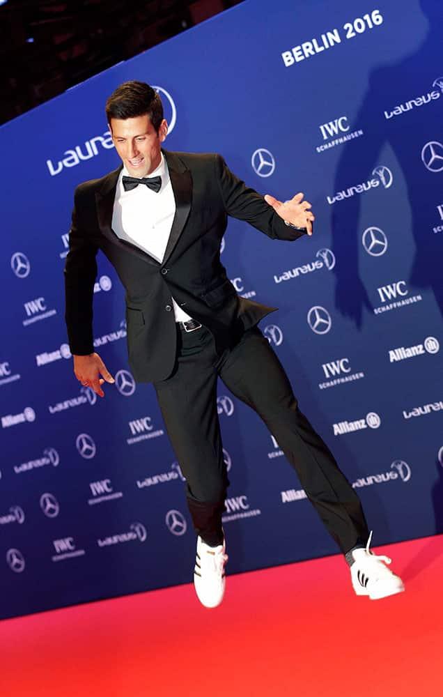Novak Dokovic jumps as he arrives for the Laureus World Sports Awards in Berlin, German.